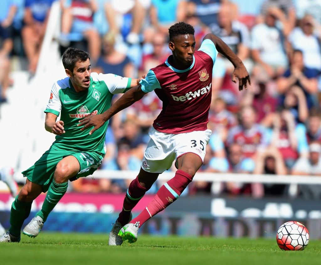 LONDON, ENGLAND - AUGUST 02: Reece Oxford of West Ham United is tackled by Fin Bartels of SV Werder Bremen during the Betway Cup match between West Ham Utd and SV Werder Bremen at Boleyn Ground on August 2, 2015 in London, England. (Photo by Tony Marshall/Getty Images)