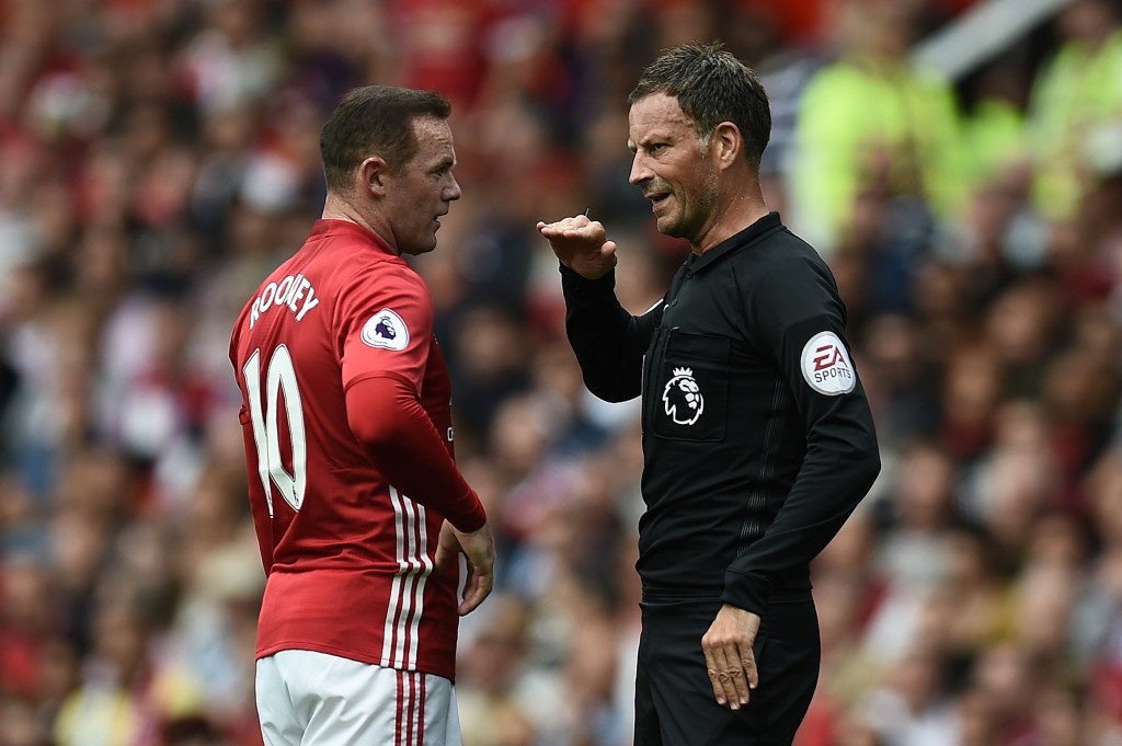 Manchester United's English striker Wayne Rooney (L) is spoken to by referee Mark Clattenburg during the English Premier League football match between Manchester United and Manchester City at Old Trafford in Manchester, north west England, on September 10, 2016. / AFP / Oli SCARFF / RESTRICTED TO EDITORIAL USE. No use with unauthorized audio, video, data, fixture lists, club/league logos or 'live' services. Online in-match use limited to 75 images, no video emulation. No use in betting, games or single club/league/player publications. / (Photo credit should read OLI SCARFF/AFP/Getty Images)