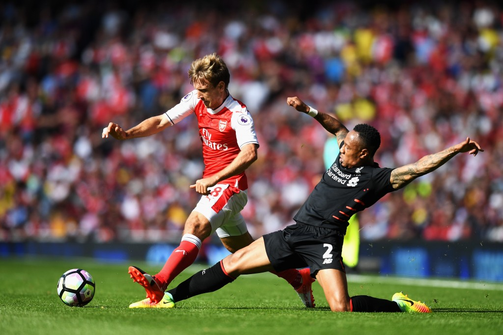 LONDON, ENGLAND - AUGUST 14: Nacho Monreal of Arsenal is tackled by Nathaniel Clyne of Liverpool during the Premier League match between Arsenal and Liverpool at Emirates Stadium on August 14, 2016 in London, England. (Photo by Michael Regan/Getty Images)