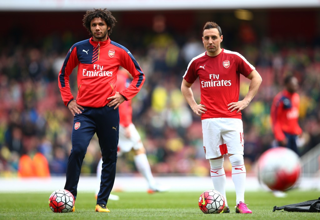 LONDON, ENGLAND - APRIL 30: Mohamed Elneny (L) and Santi Cazorla of Arsenal are seen during the warm up prior to the Barclays Premier League match between Arsenal and Norwich City at The Emirates Stadium on April 30, 2016 in London, England (Photo by Paul Gilham/Getty Images)