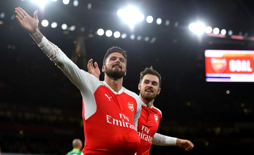 LONDON, ENGLAND - DECEMBER 05: Olivier Giroud (L) of Arsenal celebrates scoring his team's second goal with his team mate Aaron Ramsey (R)during the Barclays Premier League match between Arsenal and Sunderland at Emirates Stadiumon December 5, 2015 in London, England. (Photo by Shaun Botterill/Getty Images)