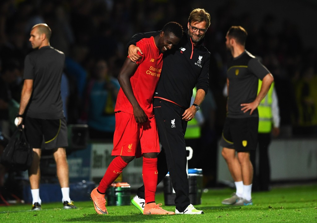BURTON UPON TRENT, ENGLAND - AUGUST 23: Jurgen Klopp, Manager of Liverpool celebrates with Divock Origi of Liverpool after the EFL Cup second round match between Burton Albion and Liverpool at Pirelli Stadium on August 23, 2016 in Burton upon Trent, England. (Photo by Gareth Copley/Getty Images)