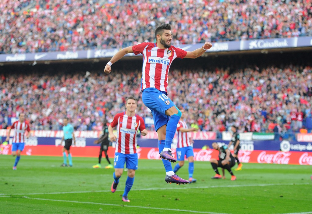 MADRID, SPAIN - OCTOBER 15: Yannick Carrasco of Club Atletico de Madrid celebrates after scoring his team's opning goal during the La Liga match between Club Atletico de Madrid and Granada CF at Vicente Calderon Stadium on October 15, 2016 in Madrid, Spain. (Photo by Denis Doyle/Getty Images)