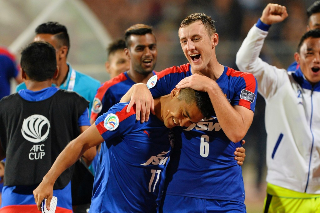 Bengaluru's John Johnson (R) congratulates his team captain Sunil Chhetri on scoring two goals as they celebrate after winning the 2016 Asian Football Confederation (AFC) Cup semi-final second leg football match between Bengaluru FC and Johor Darul Ta'zim at the Shree Kanteerava stadium in Bangalore, on October 19, 2016. / AFP / MANJUNATH KIRAN (Photo credit should read MANJUNATH KIRAN/AFP/Getty Images)