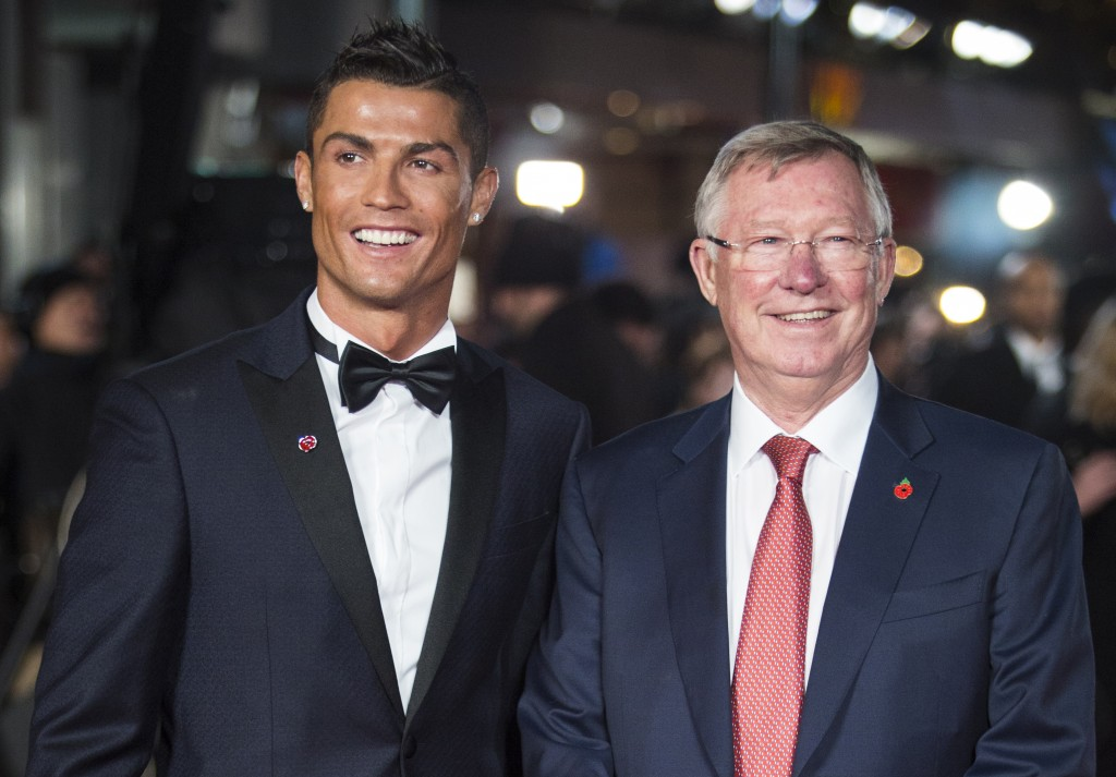Real Madrid's Portuguese forward Cristiano Ronaldo (L) poses with former Manchester United manager Sir Alex Ferguson at the world premiere of the film Ronaldo in central London on November 9, 2015. AFP PHOTO / JACK TAYLOR / AFP / JACK TAYLOR (Photo credit should read JACK TAYLOR/AFP/Getty Images)