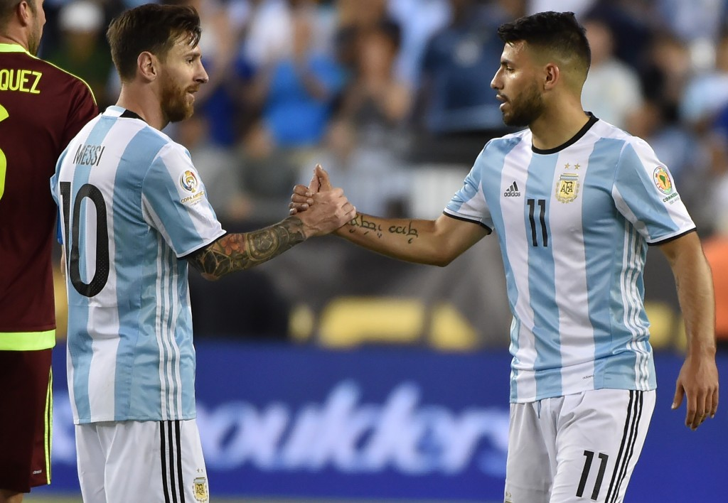 Argentina's Lionel Messi (L) greets Argentina's Sergio Aguero after their Copa America Centenario football quarterfinal match against Venezuela in Foxborough, Massachusetts, United States, on June 18, 2016. / AFP / Nelson ALMEIDA (Photo credit should read NELSON ALMEIDA/AFP/Getty Images)