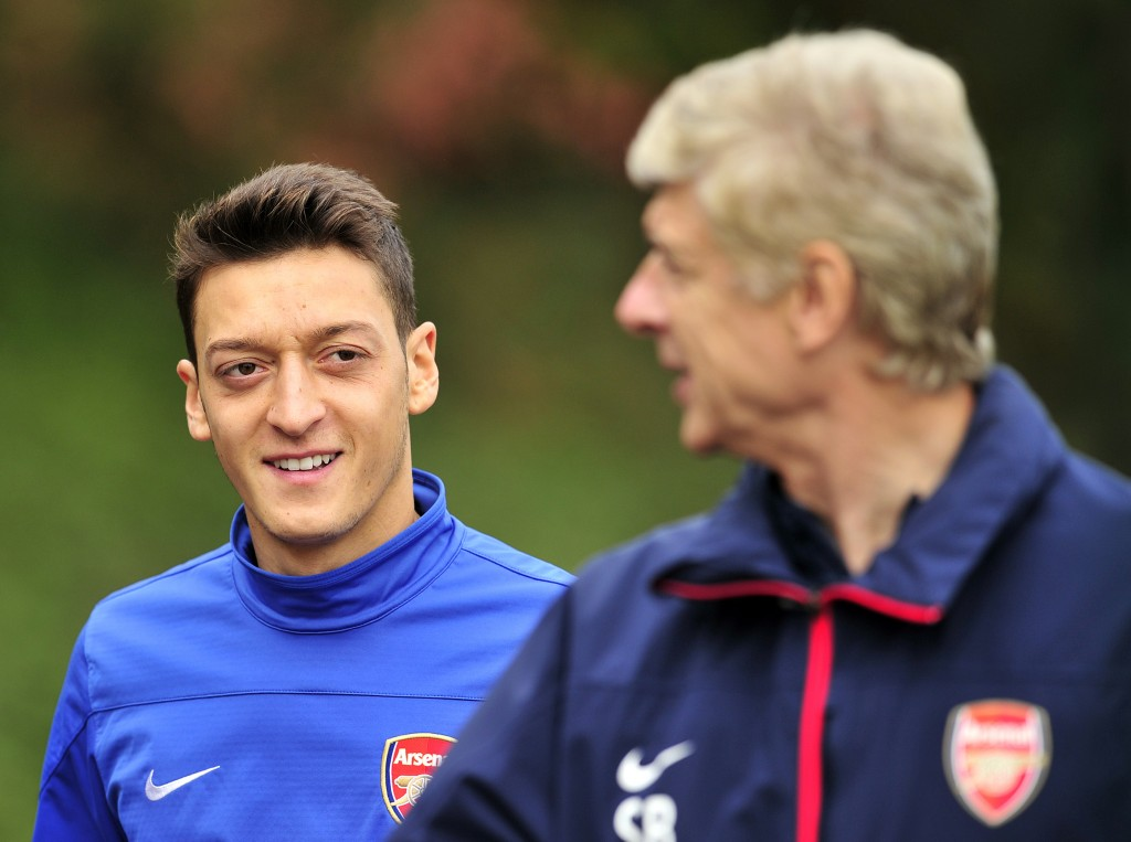 Mutual admiration. (Picture CoArsenal's German midfielder Mesut Ozil (L) and French manager Arsene Wenger (R) speak during a team training session at Arsenal's London Colney training ground in north London. (Photo by Glyn Kirk/AFP/Getty Images)