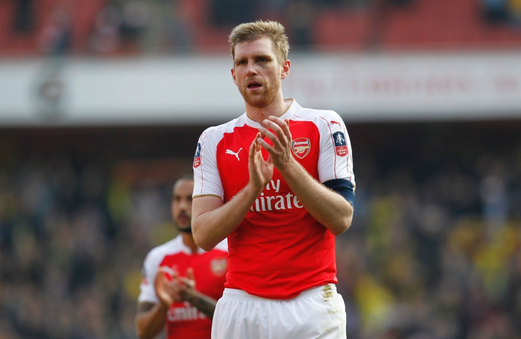 Arsenal's German defender Per Mertesacker appauds supporters after the English FA Cup quarter final football match between Arsenal and Watford at the Emirates Stadium in London on March 13, 2016. Watford won the game 2-1. / AFP / Ian Kington / RESTRICTED TO EDITORIAL USE. No use with unauthorized audio, video, data, fixture lists, club/league logos or 'live' services. Online in-match use limited to 75 images, no video emulation. No use in betting, games or single club/league/player publications. / (Photo credit should read IAN KINGTON/AFP/Getty Images)