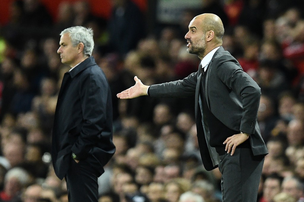 Manchester City's Spanish manager Pep Guardiola (R) gestures on the touchline during the EFL (English Football League) Cup fourth round match between Manchester United and Manchester City at Old Trafford in Manchester, north west England on October 26, 2016. Manchester United won the game 1-0. / AFP / Oli SCARFF / RESTRICTED TO EDITORIAL USE. No use with unauthorized audio, video, data, fixture lists, club/league logos or 'live' services. Online in-match use limited to 75 images, no video emulation. No use in betting, games or single club/league/player publications. / (Photo credit should read OLI SCARFF/AFP/Getty Images)