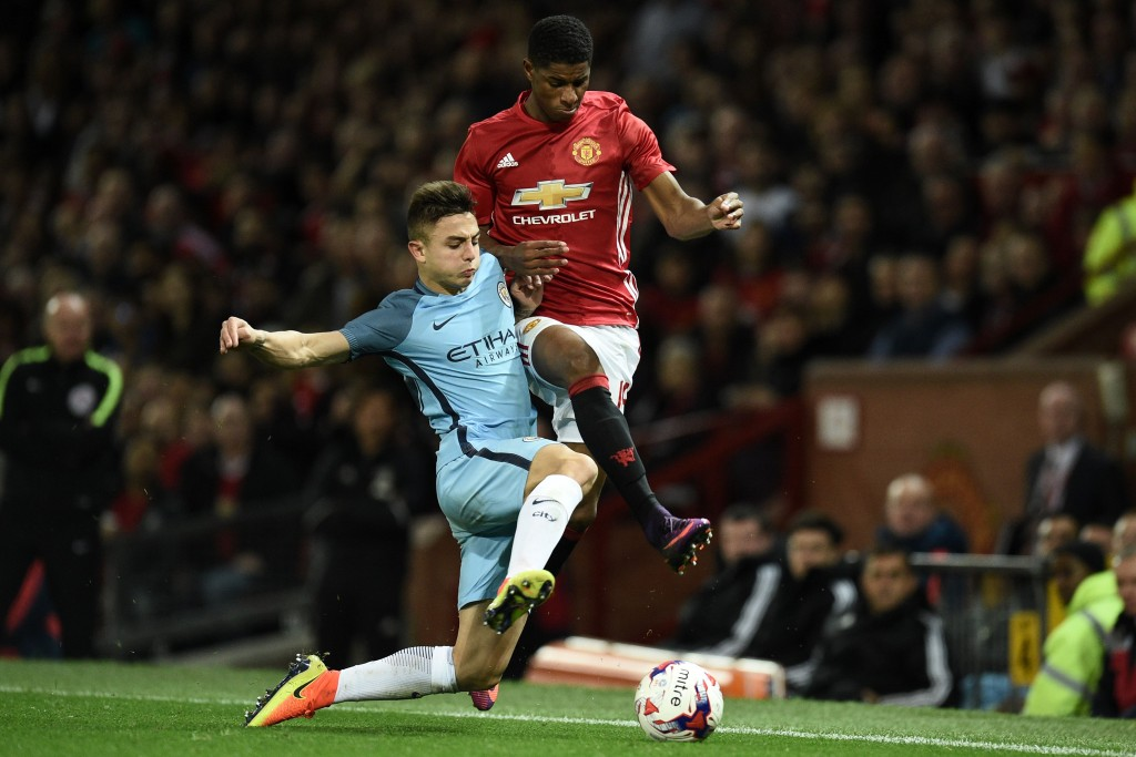 Manchester City's Spanish defender Pablo Maffeo (L) vies with Manchester United's English striker Marcus Rashford during the EFL (English Football League) Cup fourth round match between Manchester United and Manchester City at Old Trafford in Manchester, north west England on October 26, 2016. / AFP / Oli SCARFF / RESTRICTED TO EDITORIAL USE. No use with unauthorized audio, video, data, fixture lists, club/league logos or 'live' services. Online in-match use limited to 75 images, no video emulation. No use in betting, games or single club/league/player publications. / (Photo credit should read OLI SCARFF/AFP/Getty Images)