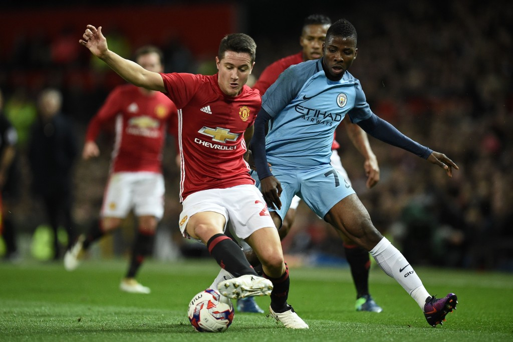 Manchester United's Spanish midfielder Ander Herrera (L) vies with Manchester City's Nigerian striker Kelechi Iheanacho during the EFL (English Football League) Cup fourth round match between Manchester United and Manchester City at Old Trafford in Manchester, north west England on October 26, 2016. / AFP / Oli SCARFF / RESTRICTED TO EDITORIAL USE. No use with unauthorized audio, video, data, fixture lists, club/league logos or 'live' services. Online in-match use limited to 75 images, no video emulation. No use in betting, games or single club/league/player publications. / (Photo credit should read OLI SCARFF/AFP/Getty Images)