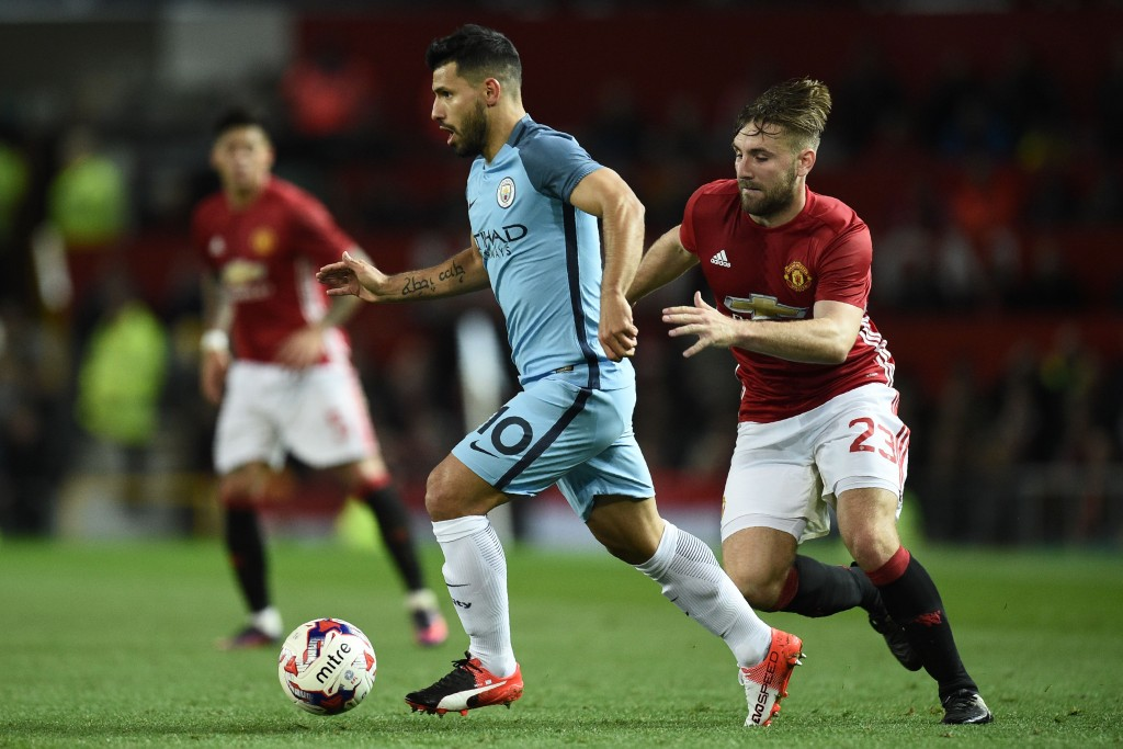 Manchester City's Argentinian striker Sergio Aguero (L) vies with Manchester United's English defender Luke Shaw during the EFL (English Football League) Cup fourth round match between Manchester United and Manchester City at Old Trafford in Manchester, north west England on October 26, 2016. Manchester United won the game 1-0. (Photo by Oli Scarff/AFP/Getty Images)