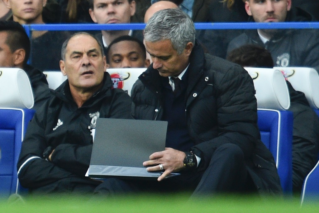 Manchester United's Portuguese manager Jose Mourinho makes notes during the English Premier League football match between Chelsea and Manchester United at Stamford Bridge in London on October 23, 2016. / AFP / Glyn KIRK / RESTRICTED TO EDITORIAL USE. No use with unauthorized audio, video, data, fixture lists, club/league logos or 'live' services. Online in-match use limited to 75 images, no video emulation. No use in betting, games or single club/league/player publications. / (Photo credit should read GLYN KIRK/AFP/Getty Images)
