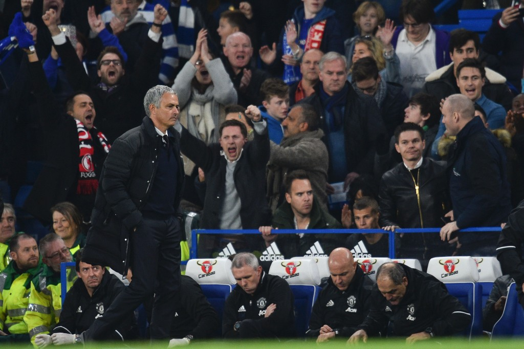 Manchester United's Portuguese manager Jose Mourinho (L) starts walking toward the tunnel at the final whistle of the English Premier League football match between Chelsea and Manchester United at Stamford Bridge in London on October 23, 2016. / AFP / GLYN KIRK / RESTRICTED TO EDITORIAL USE. No use with unauthorized audio, video, data, fixture lists, club/league logos or 'live' services. Online in-match use limited to 75 images, no video emulation. No use in betting, games or single club/league/player publications. / (Photo credit should read GLYN KIRK/AFP/Getty Images)