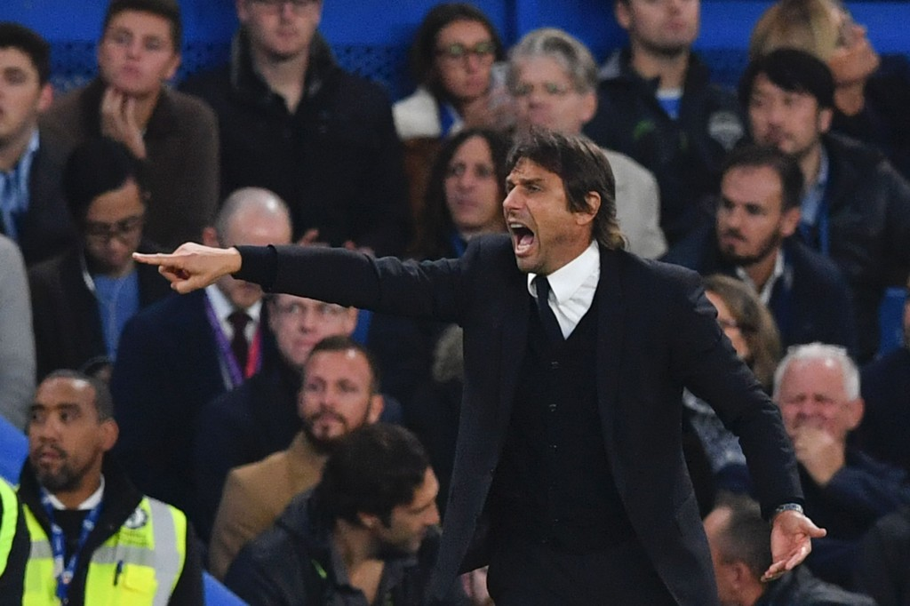 Chelsea's Italian head coach Antonio Conte gestures on the touchline during the English Premier League football match between Chelsea and Manchester United at Stamford Bridge in London on October 23, 2016. / AFP / BEN STANSALL / RESTRICTED TO EDITORIAL USE. No use with unauthorized audio, video, data, fixture lists, club/league logos or 'live' services. Online in-match use limited to 75 images, no video emulation. No use in betting, games or single club/league/player publications. / (Photo credit should read BEN STANSALL/AFP/Getty Images)