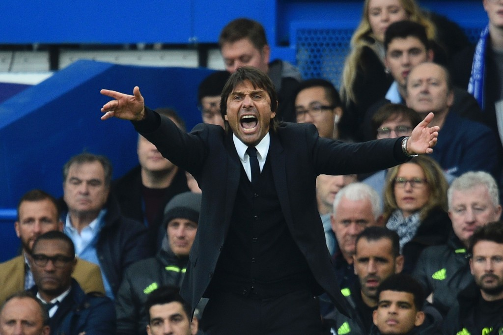 Chelsea's Italian head coach Antonio Conte gestures from the touchline during the English Premier League football match between Chelsea and Manchester United at Stamford Bridge in London on October 23, 2016. / AFP / GLYN KIRK / RESTRICTED TO EDITORIAL USE. No use with unauthorized audio, video, data, fixture lists, club/league logos or 'live' services. Online in-match use limited to 75 images, no video emulation. No use in betting, games or single club/league/player publications. / (Photo credit should read GLYN KIRK/AFP/Getty Images)