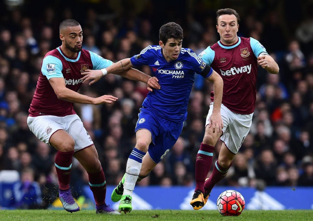 Chelsea's Brazilian midfielder Oscar (C) vies with West Ham United's New Zealand defender Winston Reid (L) and West Ham United's English midfielder Mark Noble during the English Premier League football match between Chelsea and West Ham United at Stamford Bridge in London on March 19, 2016. The game finished 2-2. / AFP / Ben STANSALL / RESTRICTED TO EDITORIAL USE. No use with unauthorized audio, video, data, fixture lists, club/league logos or 'live' services. Online in-match use limited to 75 images, no video emulation. No use in betting, games or single club/league/player publications. / (Photo credit should read BEN STANSALL/AFP/Getty Images)