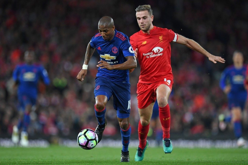 Manchester United's English midfielder Ashley Young (L) vies with Liverpool's English midfielder Jordan Henderson during the English Premier League football match between Liverpool and Manchester United at Anfield in Liverpool, north west England on October 17, 2016. / AFP / Paul ELLIS / RESTRICTED TO EDITORIAL USE. No use with unauthorized audio, video, data, fixture lists, club/league logos or 'live' services. Online in-match use limited to 75 images, no video emulation. No use in betting, games or single club/league/player publications. / (Photo credit should read PAUL ELLIS/AFP/Getty Images)