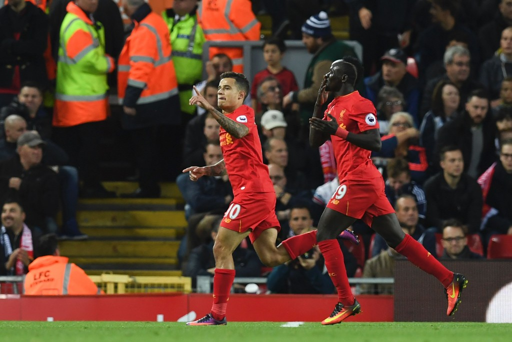 Liverpool's Brazilian midfielder Philippe Coutinho (L) celebrates scoring their second goal with Liverpool's Senegalese midfielder Sadio Mane (R) during the English Premier League football match between Liverpool and West Bromwich Albion at Anfield in Liverpool, north west England on October 22, 2016. / AFP / PAUL ELLIS / RESTRICTED TO EDITORIAL USE. No use with unauthorized audio, video, data, fixture lists, club/league logos or 'live' services. Online in-match use limited to 75 images, no video emulation. No use in betting, games or single club/league/player publications. / (Photo credit should read PAUL ELLIS/AFP/Getty Images)