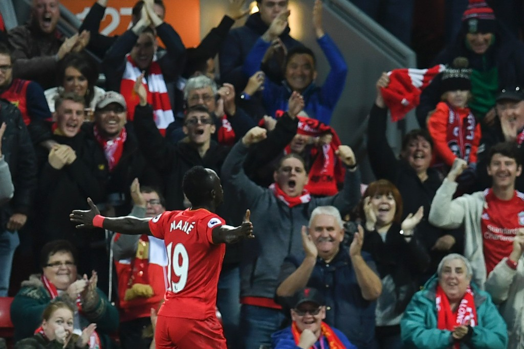 Liverpool's Senegalese midfielder Sadio Mane celebrates scoring the opening goal during the English Premier League football match between Liverpool and West Bromwich Albion at Anfield in Liverpool, north west England on October 22, 2016. / AFP / PAUL ELLIS / RESTRICTED TO EDITORIAL USE. No use with unauthorized audio, video, data, fixture lists, club/league logos or 'live' services. Online in-match use limited to 75 images, no video emulation. No use in betting, games or single club/league/player publications. / (Photo credit should read PAUL ELLIS/AFP/Getty Images)