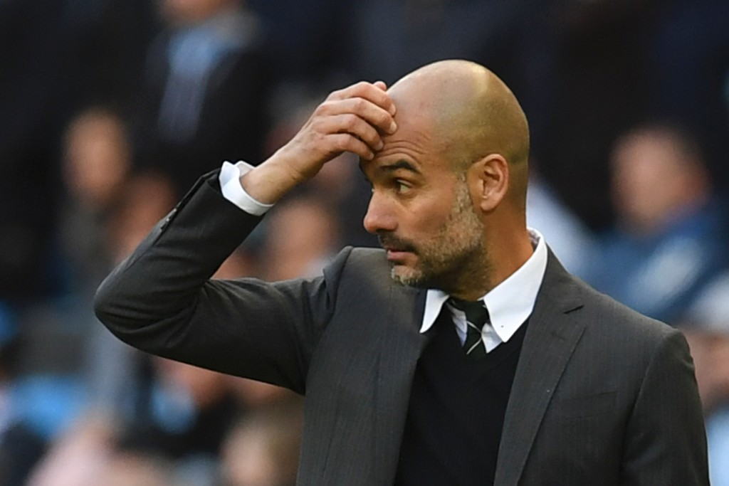 Manchester City's Spanish manager Pep Guardiola gestures on the touchline during the English Premier League football match between Manchester City and Southampton at the Etihad Stadium in Manchester, north west England, on October 23, 2016. The game finished 1-1. / AFP / Paul ELLIS / RESTRICTED TO EDITORIAL USE. No use with unauthorized audio, video, data, fixture lists, club/league logos or 'live' services. Online in-match use limited to 75 images, no video emulation. No use in betting, games or single club/league/player publications. / (Photo credit should read PAUL ELLIS/AFP/Getty Images)