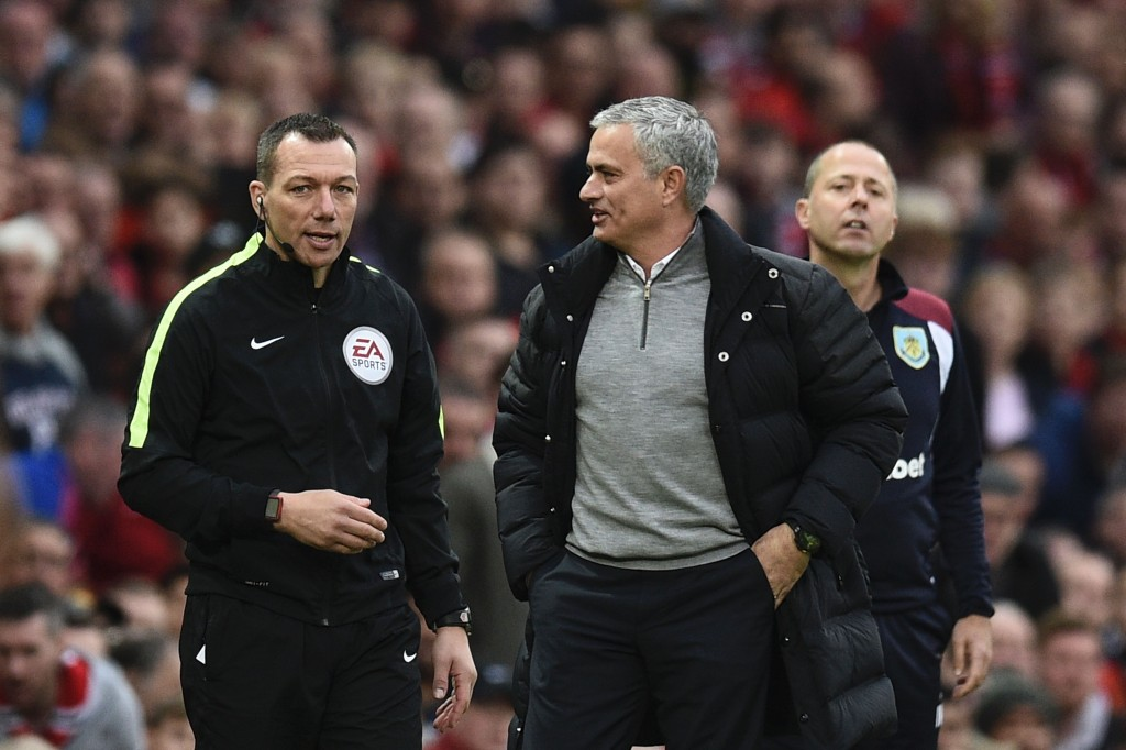 Manchester United's Portuguese manager Jose Mourinho (R) talks with fourth official Kevin Friend (L) on the touchline during the English Premier League football match between Manchester United and Burnley at Old Trafford in Manchester, north west England, on October 29, 2016. (Photo by Oli Scarff/AFP/Getty Images)