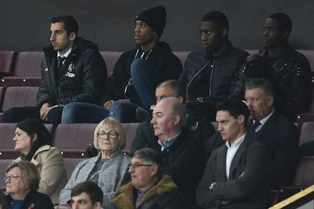 (Top row L-R) Manchester United's Armenian midfielder Henrikh Mkhitaryan, Manchester United's French striker Anthony Martial, Manchester United's Dutch defender Timothy Fosu-Mensah and Manchester United's Ivorian defender Eric Bailly all of whom were not in the squad for the match sit watching the English Premier League football match between Manchester United and Burnley at Old Trafford in Manchester, north west England, on October 29, 2016. / AFP / OLI SCARFF / RESTRICTED TO EDITORIAL USE. No use with unauthorized audio, video, data, fixture lists, club/league logos or 'live' services. Online in-match use limited to 75 images, no video emulation. No use in betting, games or single club/league/player publications. / (Photo credit should read OLI SCARFF/AFP/Getty Images)