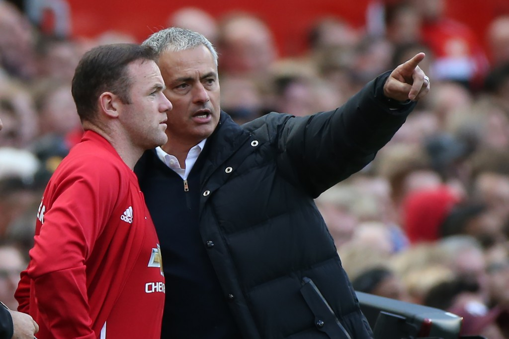 Manchester United's Portuguese manager Jose Mourinho (R) gives instructions to Manchester United's English striker Wayne Rooney as he comes on as a substitute during the English Premier League football match between Manchester United and Stoke City at Old Trafford in Manchester, north west England, on October 2, 2016. / AFP / Scott Heppell / RESTRICTED TO EDITORIAL USE. No use with unauthorized audio, video, data, fixture lists, club/league logos or 'live' services. Online in-match use limited to 75 images, no video emulation. No use in betting, games or single club/league/player publications. / (Photo credit should read SCOTT HEPPELL/AFP/Getty Images)