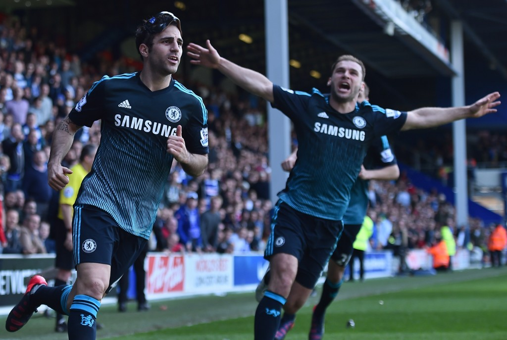 """Chelsea's Spanish midfielder Cesc Fabregas (L) celebrates with Chelsea's Serbian defender Branislav Ivanovic (R) after scoring their goal during the English Premier League football match between Queens Park Rangers and Chelsea at Loftus Road Stadium in London on April 12, 2015. Chelsea won the game 1-0. AFP PHOTO / BEN STANSALL RESTRICTED TO EDITORIAL USE. NO USE WITH UNAUTHORIZED AUDIO, VIDEO, DATA, FIXTURE LISTS, CLUB/LEAGUE LOGOS OR """"LIVE"""" SERVICES. ONLINE IN-MATCH USE LIMITED TO 45 IMAGES, NO VIDEO EMULATION. NO USE IN BETTING, GAMES OR SINGLE CLUB/LEAGUE/PLAYER PUBLICATIONS. (Photo credit should read BEN STANSALL/AFP/Getty Images)"""