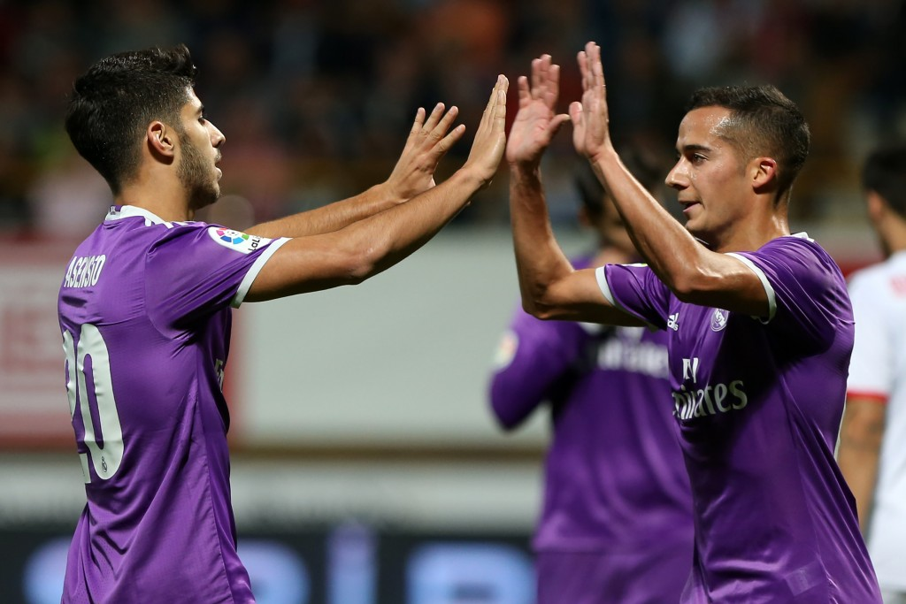 Real Madrid's midfielder Marco Asensio (L) celebrates a goal with Real Madrid's midfielder Lucas Vazquez during the Spanish Copa del Rey (King's Cup) round of 32 first leg football match between Cultural y Deportiva Leonesa and Real Madrid at the Reino de Leon stadium in Leon, on October 26, 2016. / AFP / CESAR MANSO (Photo credit should read CESAR MANSO/AFP/Getty Images)
