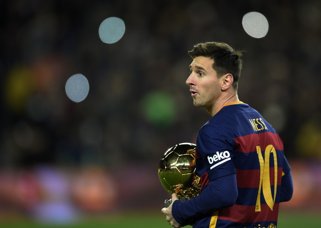 Barcelona's Argentinian forward Lionel Messi walks away after posing with his fifth Ballon d'Or trophy before the Spanish league football match FC Barcelona vs Athletic Club Bilbao at the Camp Nou stadium in Barcelona on January 17, 2016. / AFP / LLUIS GENE (Photo credit should read LLUIS GENE/AFP/Getty Images)