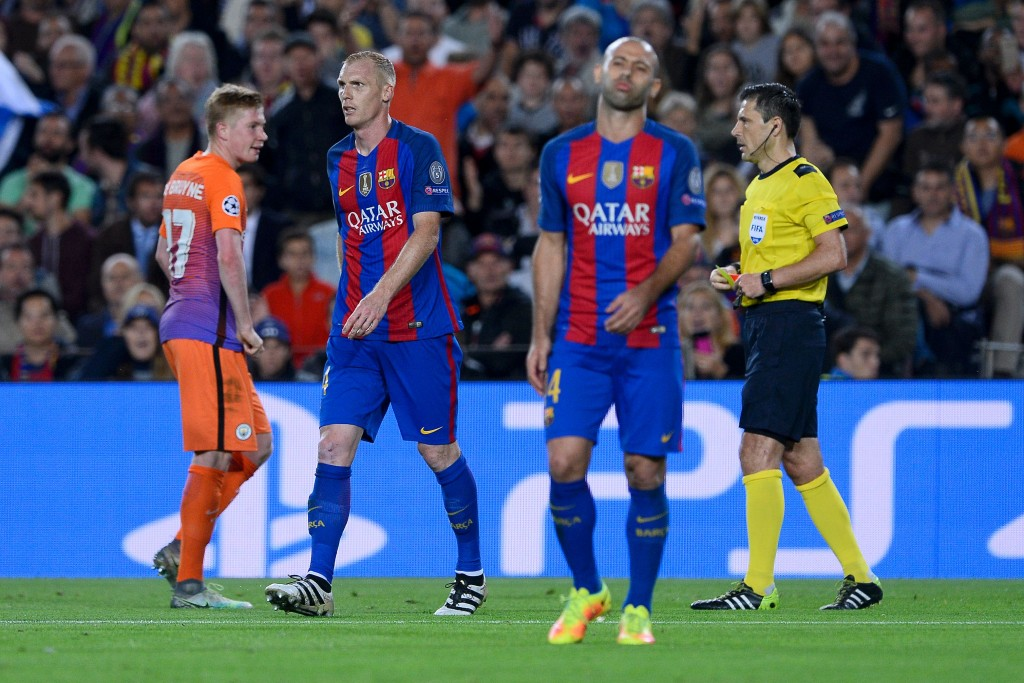 Barcelona's French defender Jeremy Mathieu (2nd L) leaves the pitch after being shown a red card during the UEFA Champions League football match FC Barcelona vs Manchester City at the Camp Nou stadium in Barcelona on October 19, 2016. (Photo by Josep Lago/AFP/Getty Images)