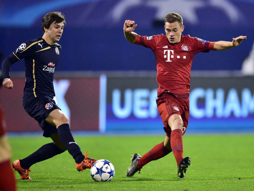 Dinamo Zagreb's midfielder Ante Coric (L) vies with Bayern Munich's midfielder Joshua Kimmich during the UEFA Champions League football match between Dinamo Zagreb v Bayern Munich at the Maksimir stadium in Zagreb on December 9, 2015. AFP PHOTO / ANDREJ ISAKOVIC / AFP / ANDREJ ISAKOVIC (Photo credit should read ANDREJ ISAKOVIC/AFP/Getty Images)