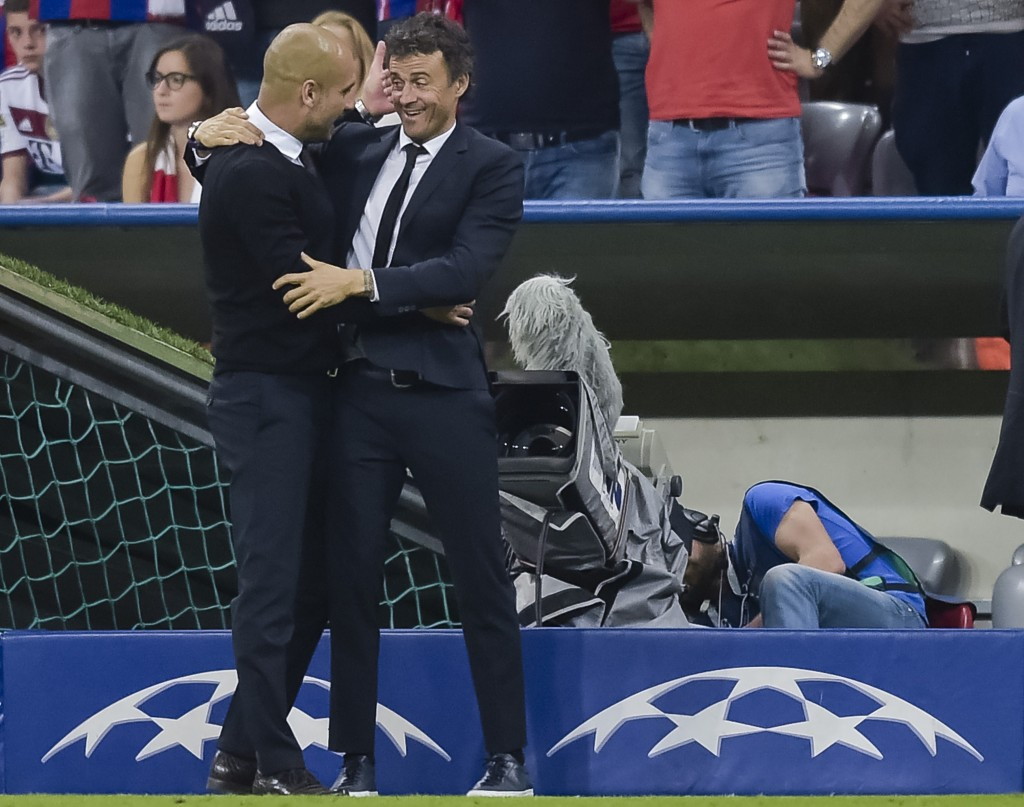Bayern Munich's Spanish head coach Pep Guardiola (L) and Barcelona's coach Luis Enrique hug after the UEFA Champions League semi-final second leg football match FC Bayern Munich vs FC Barcelona in Munich, southern Germany, on May 12, 2015. AFP PHOTO / STR (Photo credit should read -/AFP/Getty Images)