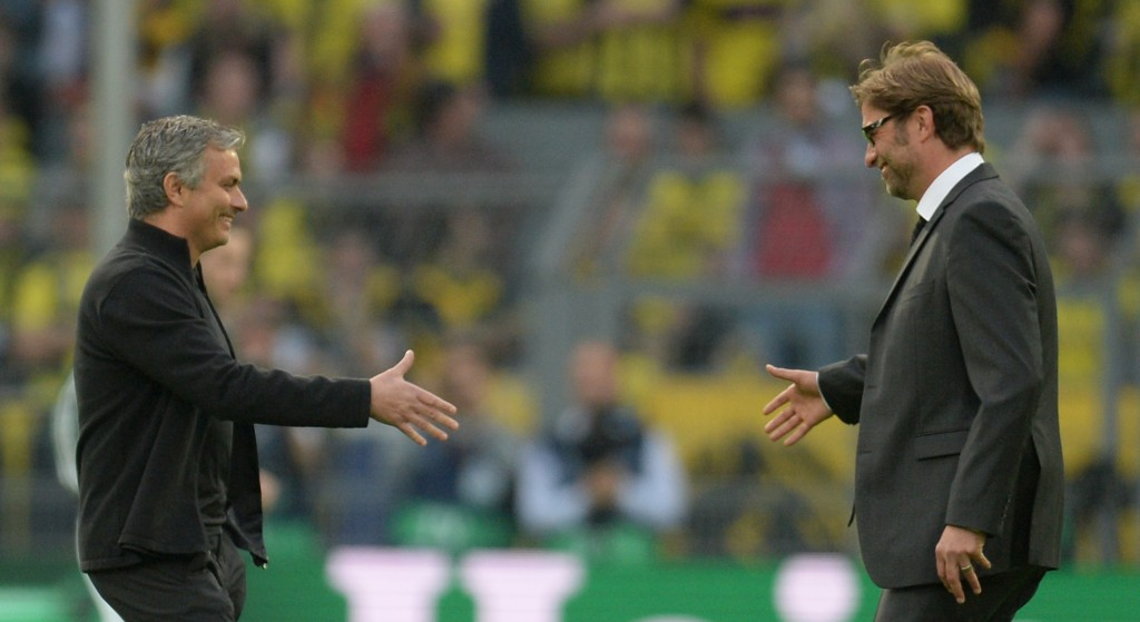Dortmund's head coach Juergen Klopp (R) shakes hands with Real Madrid's Portuguese coach Jose Mourinho prior to the UEFA Champions League semi final first leg football match between Borussia Dortmund and Real Madrid on April 24, 2013 in Dortmund, western Germany. (Photo credit: Patrik Stollarz/AFP/Getty Images)