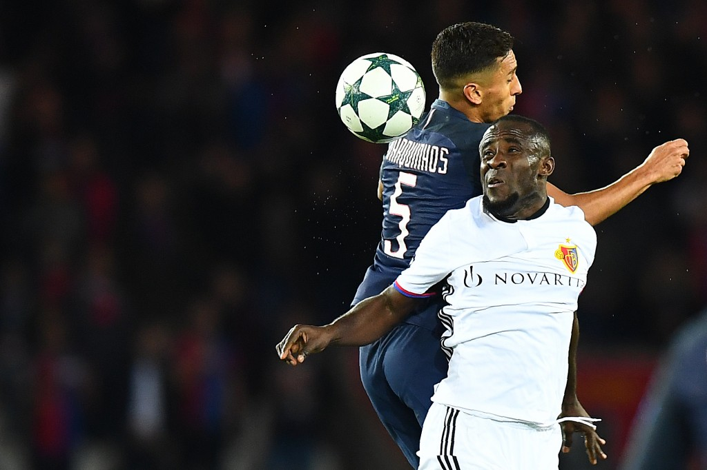 Basel's Ivorian striker Seydou Doumbia (L) heads the ball with Paris Saint-Germain's Brazilian defender Marquinhos during the UEFA Champions League group A football match between Paris Saint-Germain (PSG) and Basel at the Parc des Princes stadium in Paris on October 19, 2016. / AFP / FRANCK FIFE (Photo credit should read FRANCK FIFE/AFP/Getty Images)