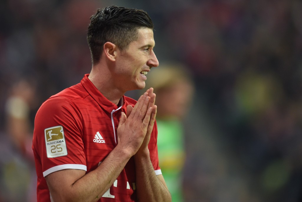 Bayern Munich's Polish forward Robert Lewandowski reacts during the German first division Bundesliga football match between FC Bayern Munich and Borussia Moenchengladbach in Munich, southern Germany, on October 22, 2016. / AFP / CHRISTOF STACHE / RESTRICTIONS: DURING MATCH TIME: DFL RULES TO LIMIT THE ONLINE USAGE TO 15 PICTURES PER MATCH AND FORBID IMAGE SEQUENCES TO SIMULATE VIDEO. == RESTRICTED TO EDITORIAL USE == FOR FURTHER QUERIES PLEASE CONTACT DFL DIRECTLY AT + 49 69 650050 (Photo credit should read CHRISTOF STACHE/AFP/Getty Images)