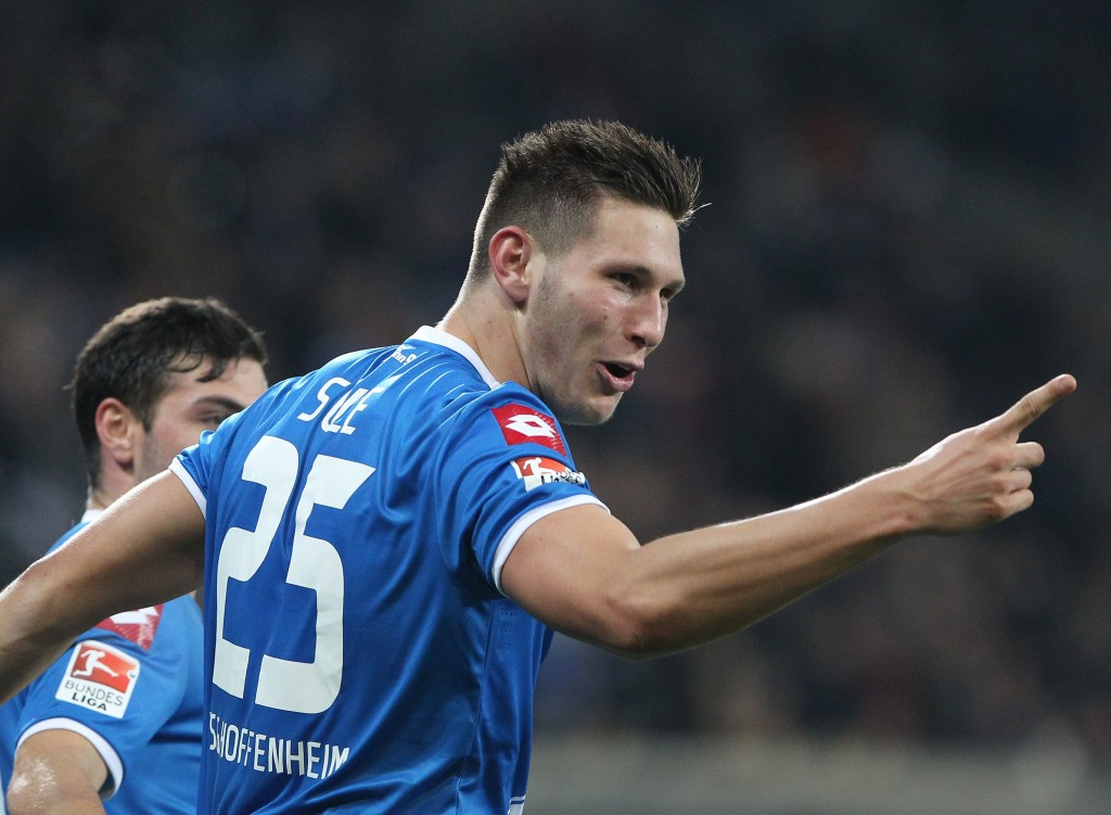 Hoffenheim's defender Niklas Suele celebrates scoring the 4-2 during the German first division Bundesliga football match 1899 Hoffenheim vs Hannover 96 in Sinsheim, southwestern Germany, on November 29, 2014. AFP PHOTO / DANIEL ROLAND RESTRICTIONS / EMBARGO DFL RULES TO LIMIT THE ONLINE USAGE DURING MATCH TIME TO 15 PICTURES PER MATCH. IMAGE SEQUENCES TO SIMULATE VIDEO IS NOT ALLOWED AT ANY TIME. FOR FURTHER QUERIES PLEASE CONTACT DFL DIRECTLY AT + 49 69 650050. (Photo credit should read DANIEL ROLAND/AFP/Getty Images)