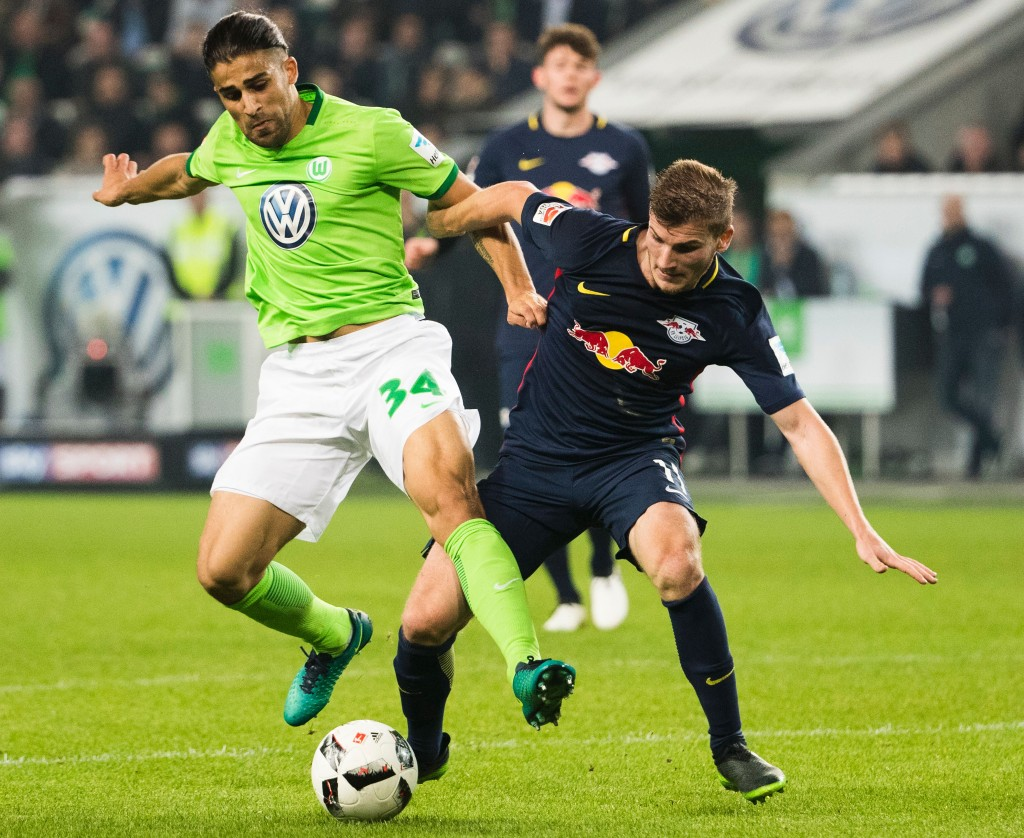 Wolfsburg's Swiss defender Ricardo Rodriguez (L) and RB Leipzig's forward Timo Werner vie for the ball during the German first division Bundesliga football match between VfL Wolfsburg and RB Leipzig, in Wolfsburg, central Germany, on October 16, 2016. / AFP / Odd ANDERSEN / RESTRICTIONS: DURING MATCH TIME: DFL RULES TO LIMIT THE ONLINE USAGE TO 15 PICTURES PER MATCH AND FORBID IMAGE SEQUENCES TO SIMULATE VIDEO. == RESTRICTED TO EDITORIAL USE == FOR FURTHER QUERIES PLEASE CONTACT DFL DIRECTLY AT + 49 69 650050 (Photo credit should read ODD ANDERSEN/AFP/Getty Images)