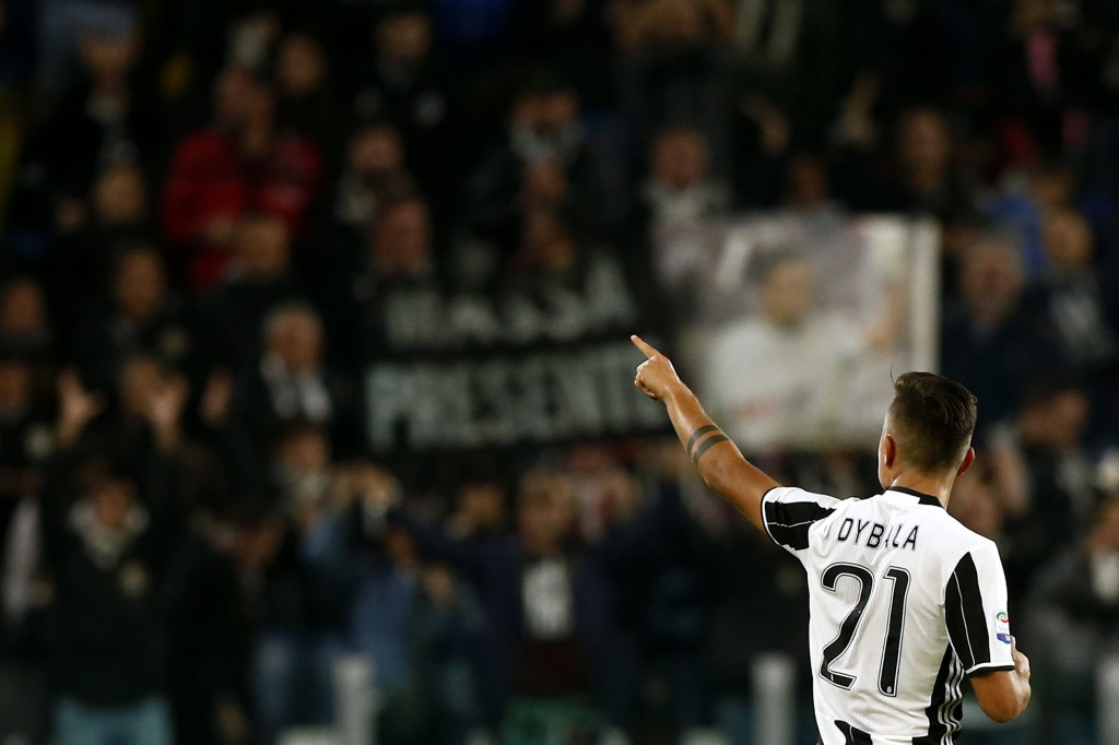 Juventus' forward Paulo Dybala from Argentina celebrates after scoring during the Italian Serie A football match Juventus vs Udinese on October 15, 2016 at the 'Juventus Stadium' in Turin. / AFP / MARCO BERTORELLO (Photo credit should read MARCO BERTORELLO/AFP/Getty Images)