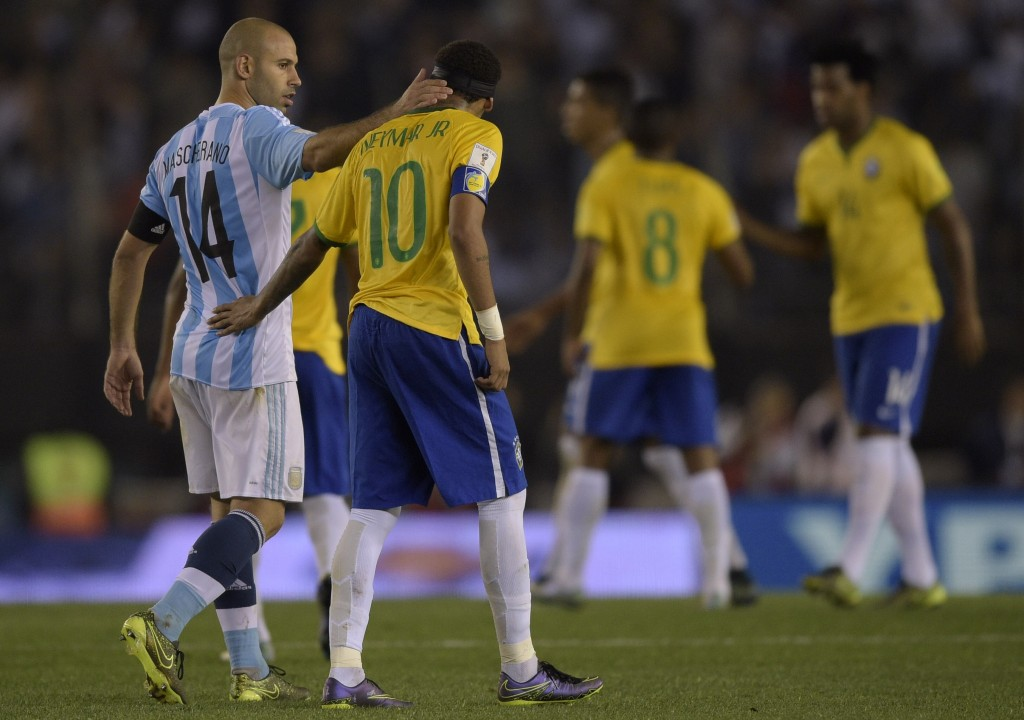 Argentina's Javier Mascherano (L) talks with Brazil's Neymar Jr. at the end of the Russia 2018 FIFA World Cup South American Qualifiers football match, in Buenos Aires, on November 13, 2015. AFP PHOTO / JUAN MABROMATA (Photo credit should read JUAN MABROMATA/AFP/Getty Images)