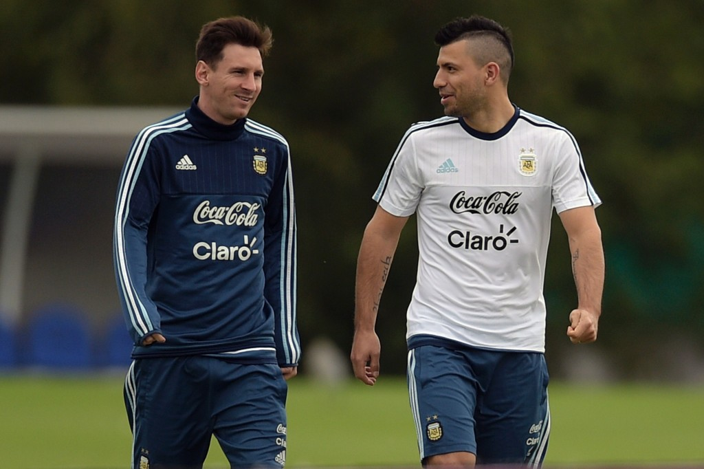 Argentina's footballers Lionel Messi (L) and Sergio Aguero walk during a training session in Ezeiza, Buenos Aires, on March 25, 2016 ahead of their March 29 Russia 2018 FIFA World Cup South American qualifier football match against Bolivia. AFP PHOTO / EITAN ABRAMOVICH / AFP / EITAN ABRAMOVICH (Photo credit should read EITAN ABRAMOVICH/AFP/Getty Images)