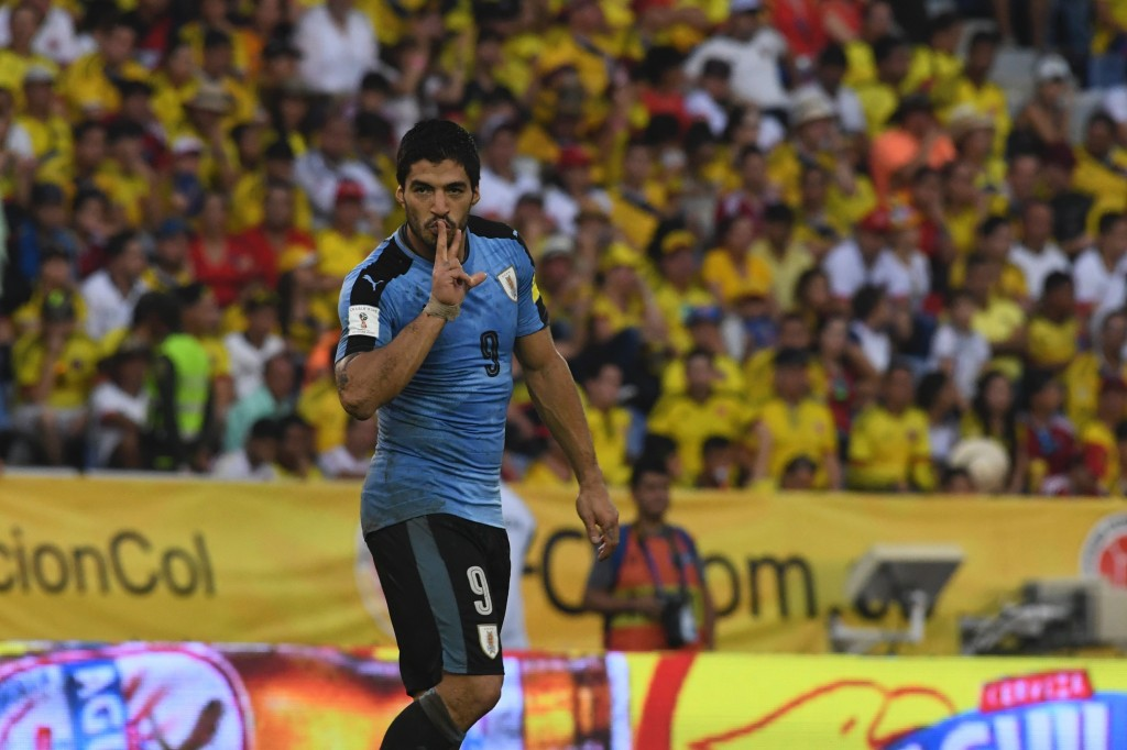 Uruguay's Luis Suarez celebrates after scoring against Colombia during their Russia 2018 World Cup qualifier football match in Barranquilla, Colombia, on October 11, 2016. / AFP / Luis Acosta (Photo credit should read LUIS ACOSTA/AFP/Getty Images)