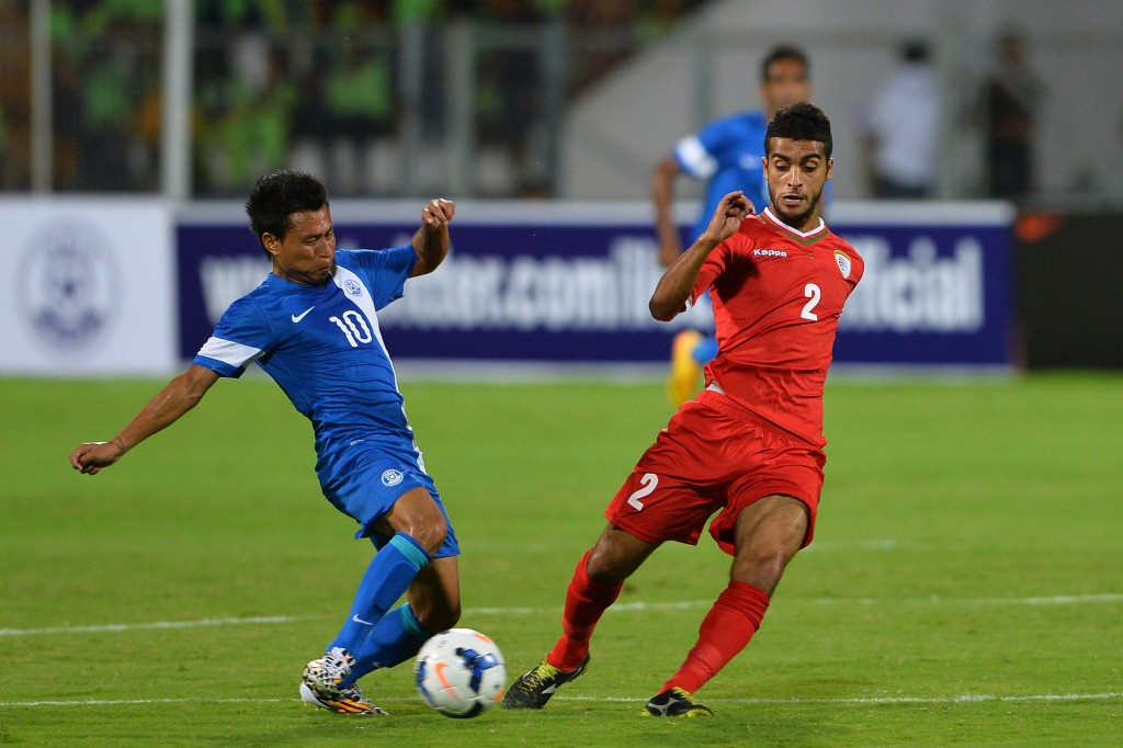 India's midfielder Jackichand Singh Talem (L) and Oman's defender Mohammed Al Musalami vie for the ball during the Asia Group D FIFA World Cup 2018 qualifying football match between India and Oman at Kanteerawa Stadium in Bangalore on June 11, 2015. AFP PHOTO / MANJUNATH KIRAN (Photo credit should read MANJUNATH KIRAN/AFP/Getty Images)