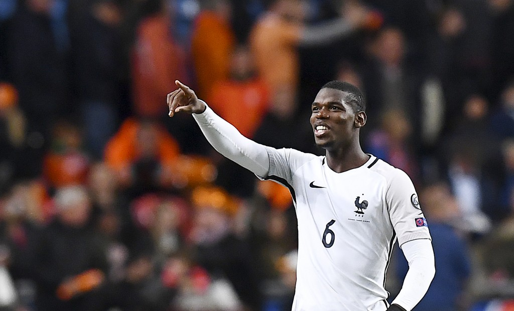 France's midfielder Paul Pogba gestures at the end of the FIFA World Cup 2018 qualifying football match between the Netherlands and France at the Arena Stadium in Amsterdam on October 10, 2016. / AFP / FRANCK FIFE (Photo credit should read FRANCK FIFE/AFP/Getty Images)