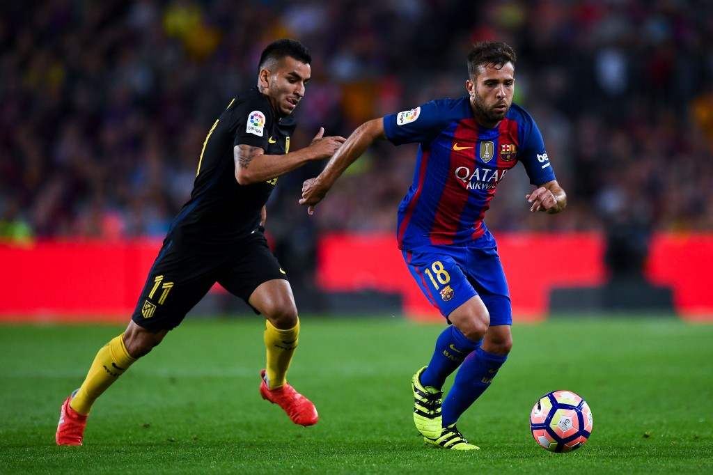 BARCELONA, SPAIN - SEPTEMBER 21: Jordi Alba of FC Barcelona competes for the ball with Angel Correa of Club Atletico de Madrid during the La Liga match between FC Barcelona and Club Atletico de Madrid at the Camp Nou stadium on September 21, 2016 in Barcelona, Spain. (Photo by David Ramos/Getty Images)