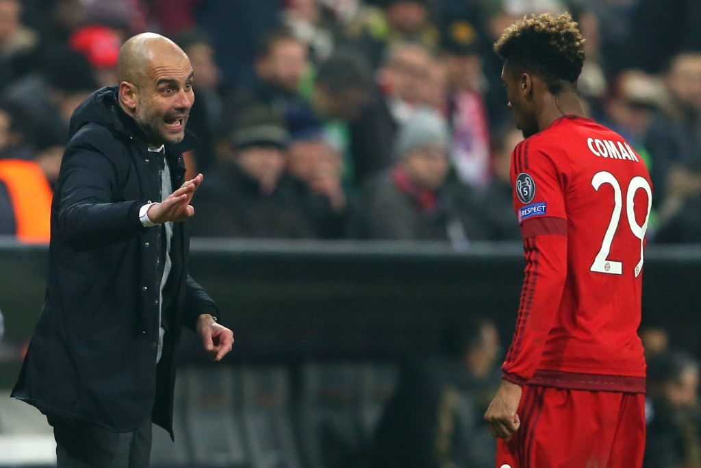 MUNICH, GERMANY - MARCH 16: Josep Guardiola, head coach of Muenchen gives intsructions to his player Kingsley Coman during the UEFA Champions League Round of 16 Second Leg match between FC Bayern Muenchen and Juventus at Allianz Arena on March 16, 2016 in Munich, Germany. (Photo by Alexander Hassenstein/Bongarts/Getty Images)