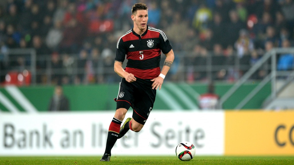 REGENSBURG, GERMANY - NOVEMBER 13: Niklas Suele of Germany runs with the ball during the 2017 UEFA European U21 Championships Qualifier between U21 Germany and U21 Azerbaijan at Continental Arena on November 13, 2015 in Regensburg, Germany. (Photo by Micha Will/Bongarts/Getty Images)