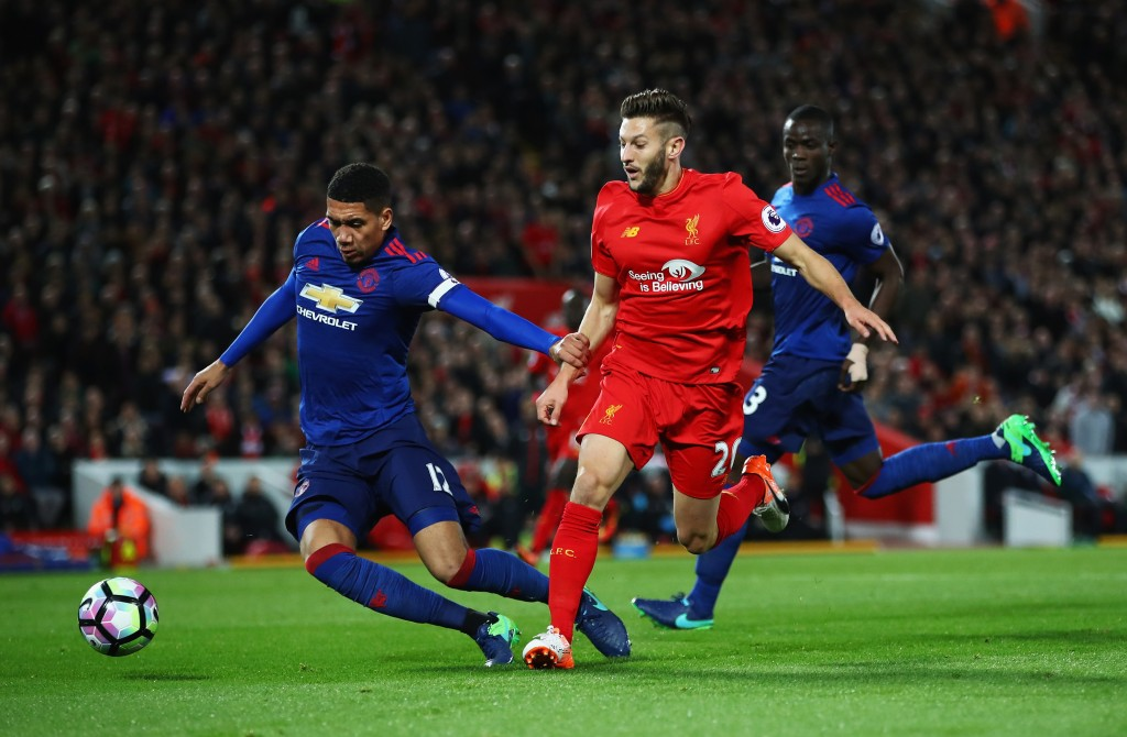 LIVERPOOL, ENGLAND - OCTOBER 17: Adam Lallana of Liverpool is challenged by Chris Smalling of Manchester United during the Premier League match between Liverpool and Manchester United at Anfield on October 17, 2016 in Liverpool, England. (Photo by Clive Brunskill/Getty Images)