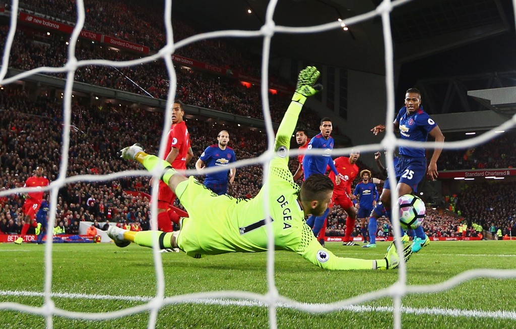 LIVERPOOL, ENGLAND - OCTOBER 17: David De Gea of Manchester United saves from Emre Can of Liverpool during the Premier League match between Liverpool and Manchester United at Anfield on October 17, 2016 in Liverpool, England. (Photo by Clive Brunskill/Getty Images)